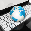 World globe on a laptop computer — Stock Photo