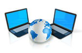 Two Laptop computers around a world globe — Stock Photo