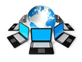 Laptop computers around a world globe — Stock Photo