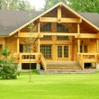 Beautiful wooden house - Stock Photo