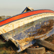 Broken boat abandoned on land — Stock Photo