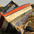 Broken boat abandoned on land — Stock Photo #6658033