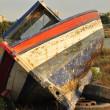 Broken boat abandoned on land — Stock Photo