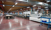 Clothing factory - Automatically cutting textile web — Stock Photo