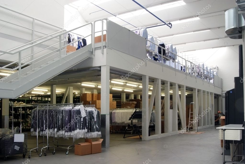Italian clothing factory - Automatic warehouse. In this Italian factory are created and distributed worldwide shirts and pants made in italy. — Stock Photo #6493781
