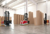 Automated warehouse (paper) with robotic forklift — Stock Photo