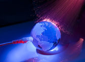 Technology earth globe against fiber optic background — Stock Photo