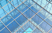 Contemporary office building blue glass wall detail — Stok fotoğraf