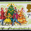 Postage stamp GREAT BRITAIN 1978 Carolers around Christmas tree — Stock Photo