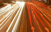 Speedy traffic on asphalt road in the evening rush hour. — Stock Photo