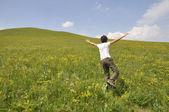 Man on green meadow — Stock Photo