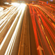 Stock Photo: Speedy traffic on asphalt road in evening rush hour.