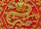 Chinese ancient wood golden flying dragon — Stock Photo