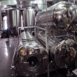 Steel tanks for beer - Stock Photo