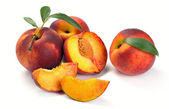 Peach and leaves — Stock Photo