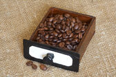 The coffee grains lay in an old box — Stock Photo