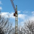 High building crane against the blue sky — Stock Photo