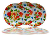Bright floral decorated dish plate on white background — Stock Photo