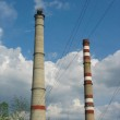 Two power plant chimneys against blue sky — Stock Photo