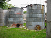 Old industrial rusty tanks for chemicals — Stock Photo
