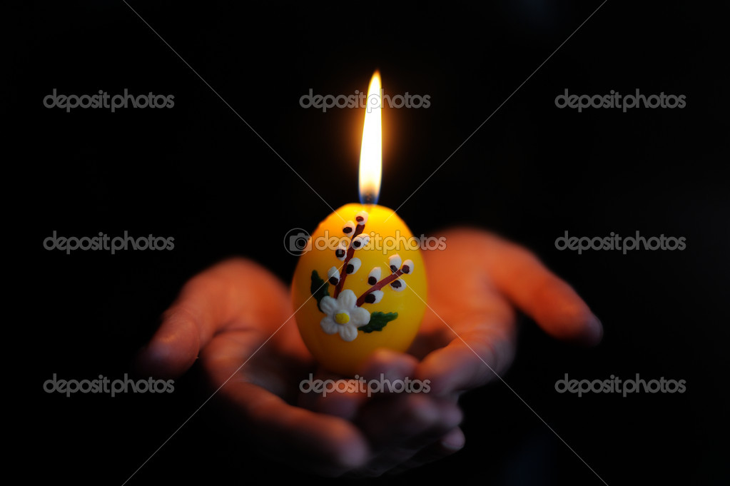 Easter candle in the hands — Stock Photo #5494639