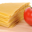 Lasagna pastawith tomato on cutting board isolated on white background — Zdjęcie stockowe
