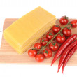 Lasagna pasta with tomato and pepper on cutting board - Stock Photo
