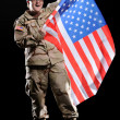 Woman in military uniform with flag in the hands — Foto de Stock