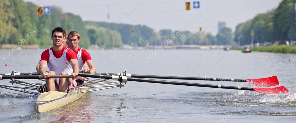 Oarsmen building up speed during a rowing race  Stock Photo #5588390