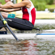 Single scull women's rowing start - Stock Photo