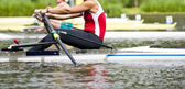 Single scull women's rowing start — Stock Photo