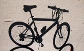 Bicycle shadow — Stock Photo