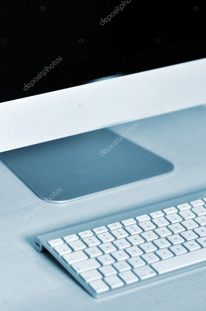 Office computer, close ip detail of a keyboard and a display monitor — Stock Photo #5638912