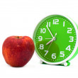 Clock and an apple — Stock Photo