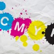 CMYK on paper - Stock Photo