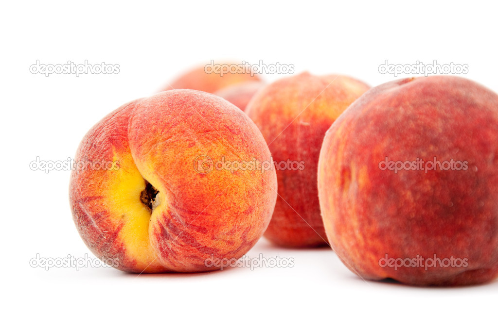 Few sweet peaches against a white background.  Stock Photo #6349655