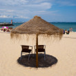 Parasol on a beach on a sunny day — Stock Photo