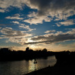 Sunset by Guadalquivir River in sevilla, spain - Stock Photo