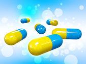 Pills on blue background — Stock Photo