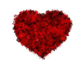 Red heart of petals on white background — Stock Photo