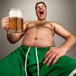 Funny fat man with glass of beer - Stock Photo