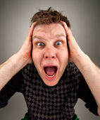 Portrait of screaming surprised man — Stock Photo