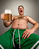 Funny fat man with glass of beer — Stockfoto