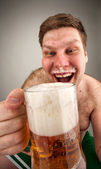Funny fat man drinking beer — Stock Photo