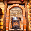 Wooden chalet with small fireplace — Stock Photo