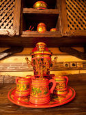 Traditional russian samovar with cups — Stock Photo
