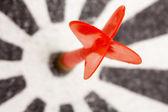 Red dart hitting the target — Stock Photo