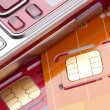 Mobile phone with sim cards - Stock Photo