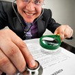 Stock Photo: Bizarre businessman examining the agreement