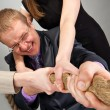 Business team pulling a rope — Stock Photo